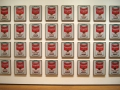 "Andy Warhol American, 1928-1987   <i>Campbell's Soup Cans</i>, 1962  Synthetic polymer paint on thirty-two canvases, Each canvas 20 x 16"" (50.8 x 40.6 cm).   Gift of Irving Blum; Nelson A. Rockefeller Bequest, gift of Mr. and Mrs. William A. M. Burden, Abby Aldrich Rockefeller Fund, gift of Nina and Gordon Bunshaft in honor of Henry Moore, Lillie P. Bliss Bequest, Philip Johnson Fund, Frances Keech Bequest, gift of Mrs. Bliss Parkinson, and Florence B. Wesley Bequest (all by exchange)    Gallery label text, 2006:  When Warhol first exhibited these thirtyЦtwo canvases in 1962, each one simultaneously hung from the wall like a painting and rested on a shelf like groceries in a store. The number of canvases corresponds to the varieties of soup then sold by the Campbell Soup Company. Warhol assigned a different flavor to each painting, referring to a product list supplied by Campbell's. There is no evidence that Warhol envisioned the canvases in a particular sequence. Here, they are arranged in rows that reflect the chronological order in which they were introduced, beginning with ""Tomato"" in the upper left, which debuted in 1897.     Publication excerpt from The Museum of Modern Art, MoMA Highlights, New York: The Museum of Modern Art, revised 2004, originally published 1999, p. 260:   ""I don't think art should be only for the select few,"" Warhol believed, ""I think it should be for the mass of the American people."" Like other Pop artists, Warhol used images of already proven appeal to huge audiences: comic strips, ads, photographs of rock-music and movie stars, tabloid news shots. In Campbell's Soup Cans he reproduced an object of mass consumption in the most literal sense. When he first exhibited these canvasesЧthere are thirty-two of them, the number of soup varieties Campbell's then soldЧeach one simultaneously hung from the wall, like a painting, and stood on a shelf, like groceries in a store.   Repeating the same image at the same scale, the canvases stress the uniformity and ubiquity of the Campbell's can. At the same time, they subvert the idea of painting as a medium of invention and originality. Visual repetition of this kind had long been used by advertisers to drum product names into the public consciousness; here, though, it implies not energetic competition but a complacent abundance. Outside an art gallery, the Campbell's label, which had not changed in over fifty years, was not an attention-grabber but a banality. As Warhol said of Campbell's soup, ""I used to drink it. I used to have the same lunch every day, for twenty years, I guess, the same thing over and over again."""